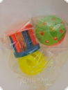 Three colorful play and rattle elements each 4 cm